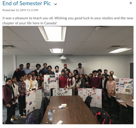 A picture of many students in a class, standing together, holding poster boards that were created by student groups. The announcment says End of Semester Pic. Posted April 16. It was a pleasure to teach you all. Wishing you good luck in your studies and the new chapter of your life here in Canada.