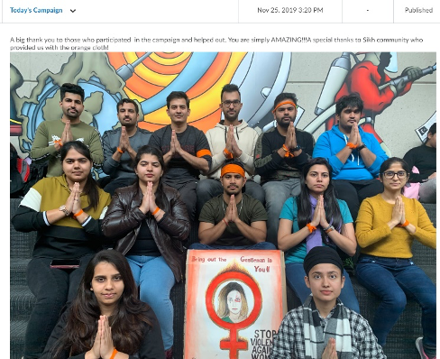 A picture with students facing a wall, with their hands folded in prayer, looking at the camera. A sign is in front with a symbol of a woman, protesting violence against women. The students wear orange bands on their arms. The Announcement says, A big thank you to those who participated in the campaign and helped out. You are simply AMAZING!! Special thanks to Sikh community who provided us with the orange cloth!